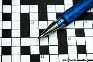Crossword puzzle with a Blue Pen Photo